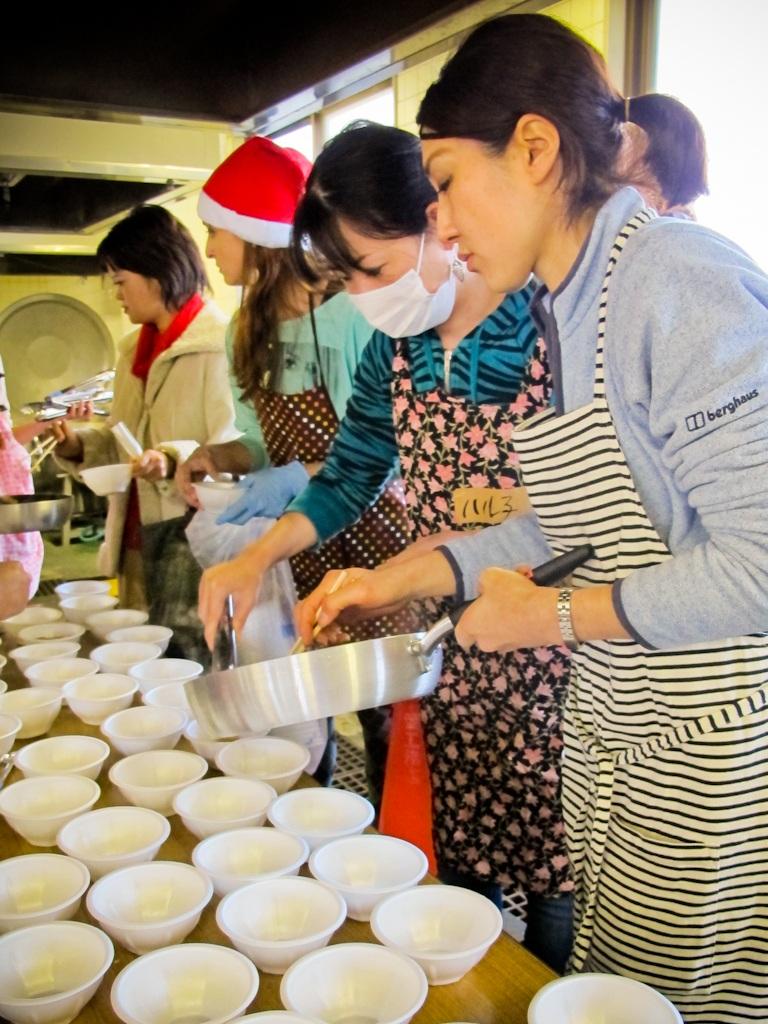 cooking, vegetables, emergency, evacuation, shelter, Fukushima, nuclear, disaster, Japan, serving