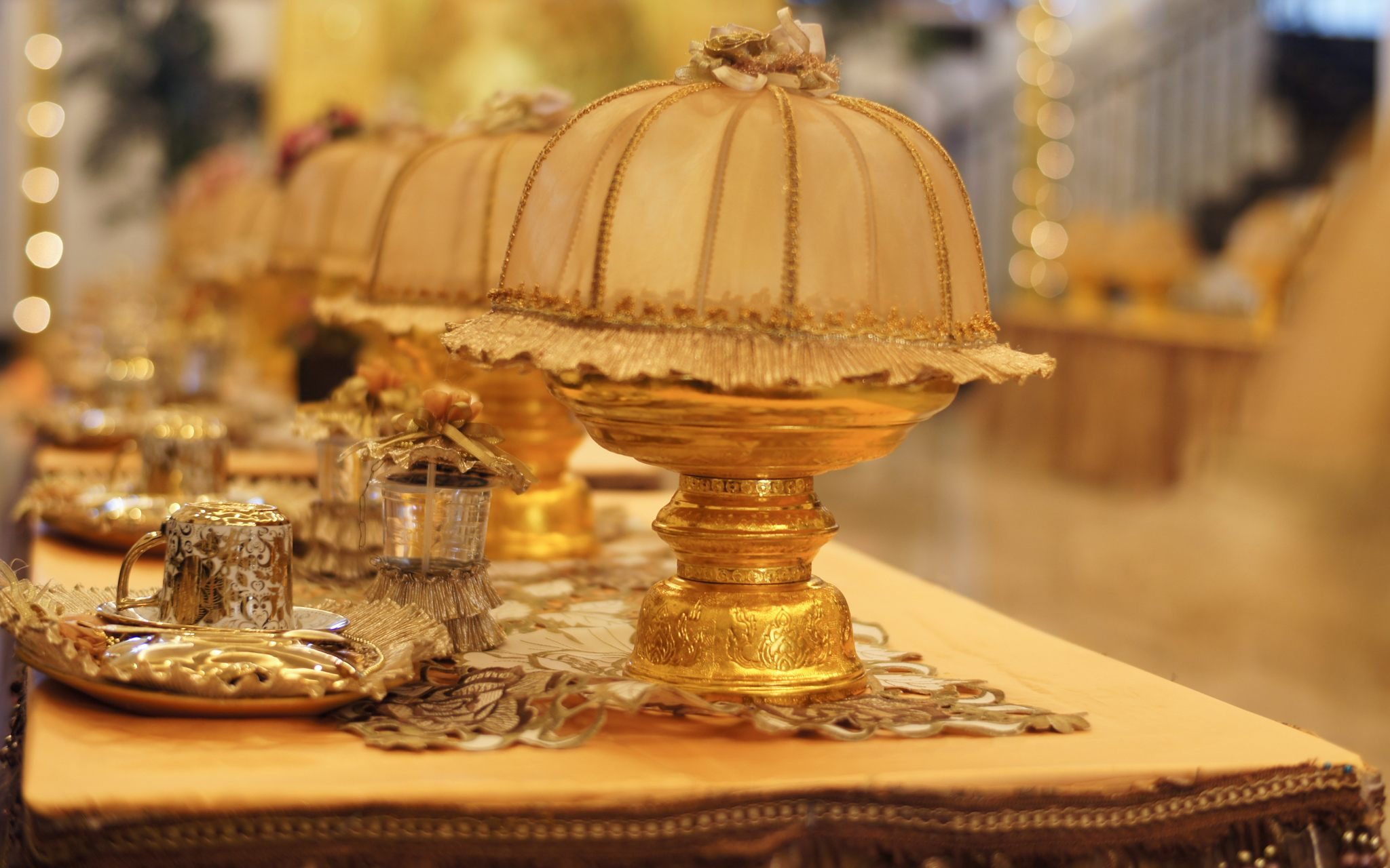 The beautiful ornate gold table settings filled with a number of moist and sweet Makassan desserts only eaten during wedding celebrations.