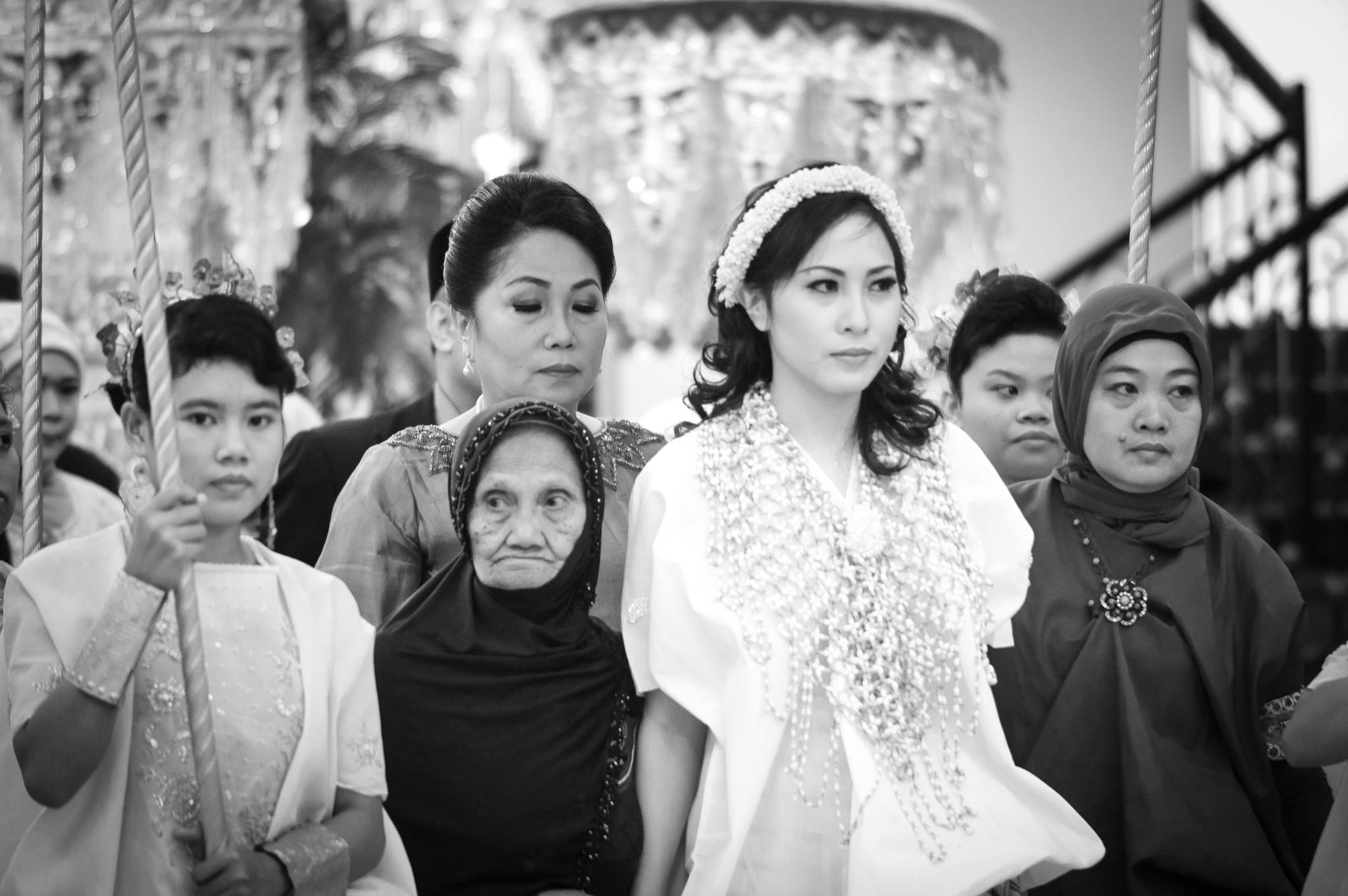 The bride-to-be enters the Mappasili, a cleansing ceremony to prepare her for entering married life.