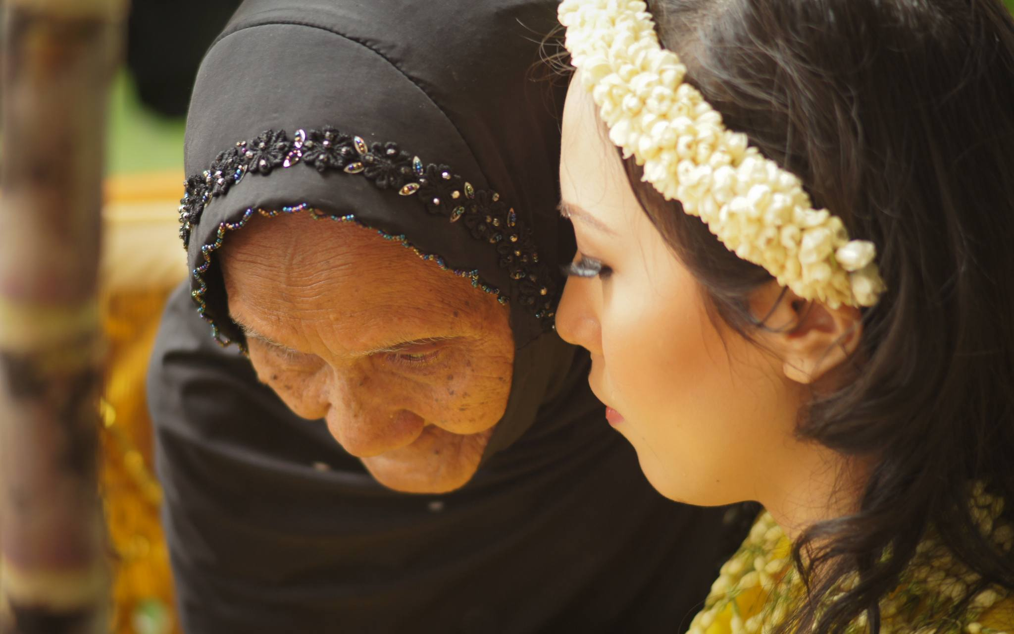 The bride-to-be is blessed by a shaman who was present to ensure a smooth spiritual transition into married life.