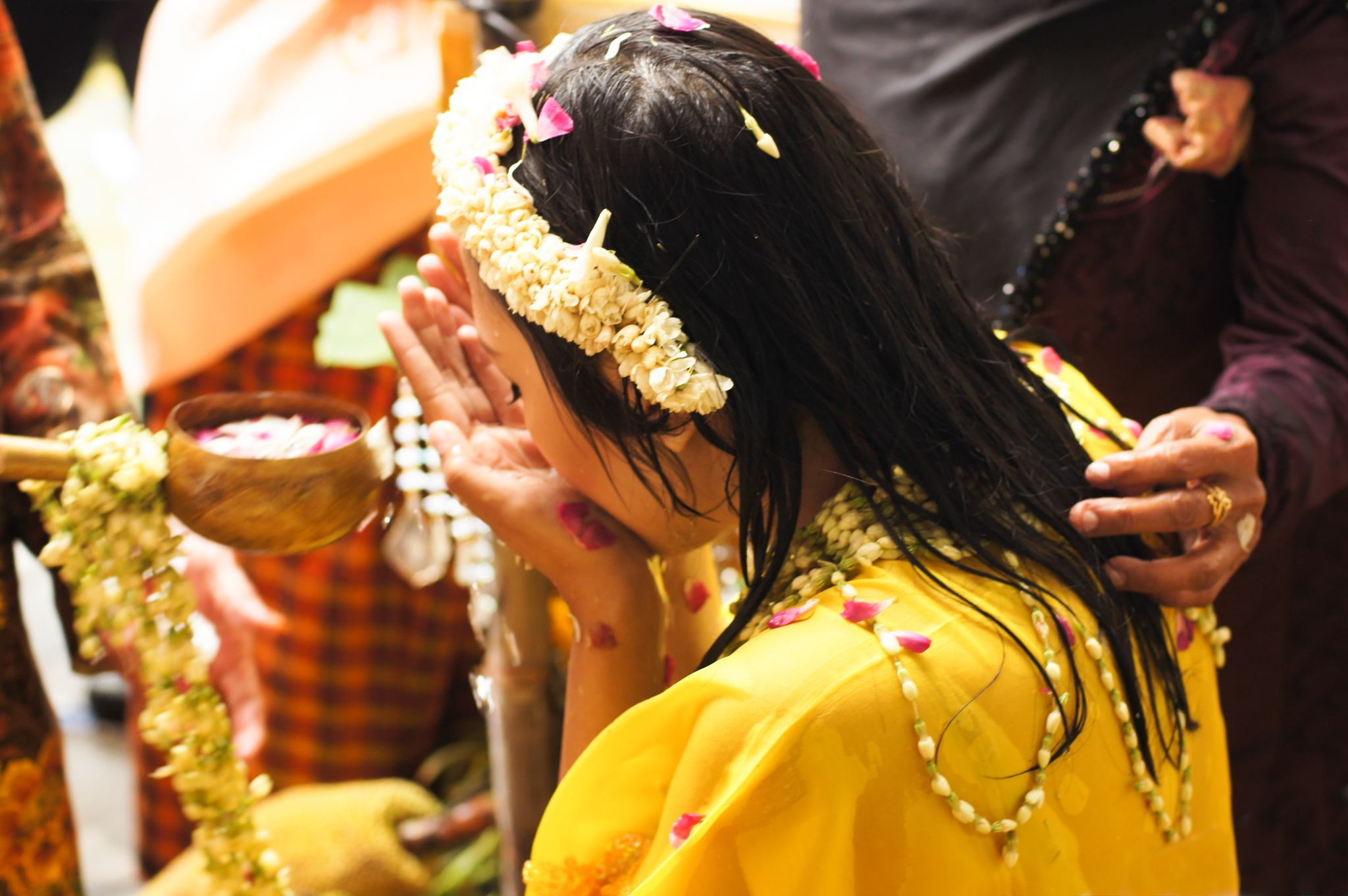 The bride-to-be is given a small amount of the water in the palms of her hands to drink before the rest of the ladle of water is showered over her head. Jessica was very honored to be invited to partake in this very intimate ceremony by the family.