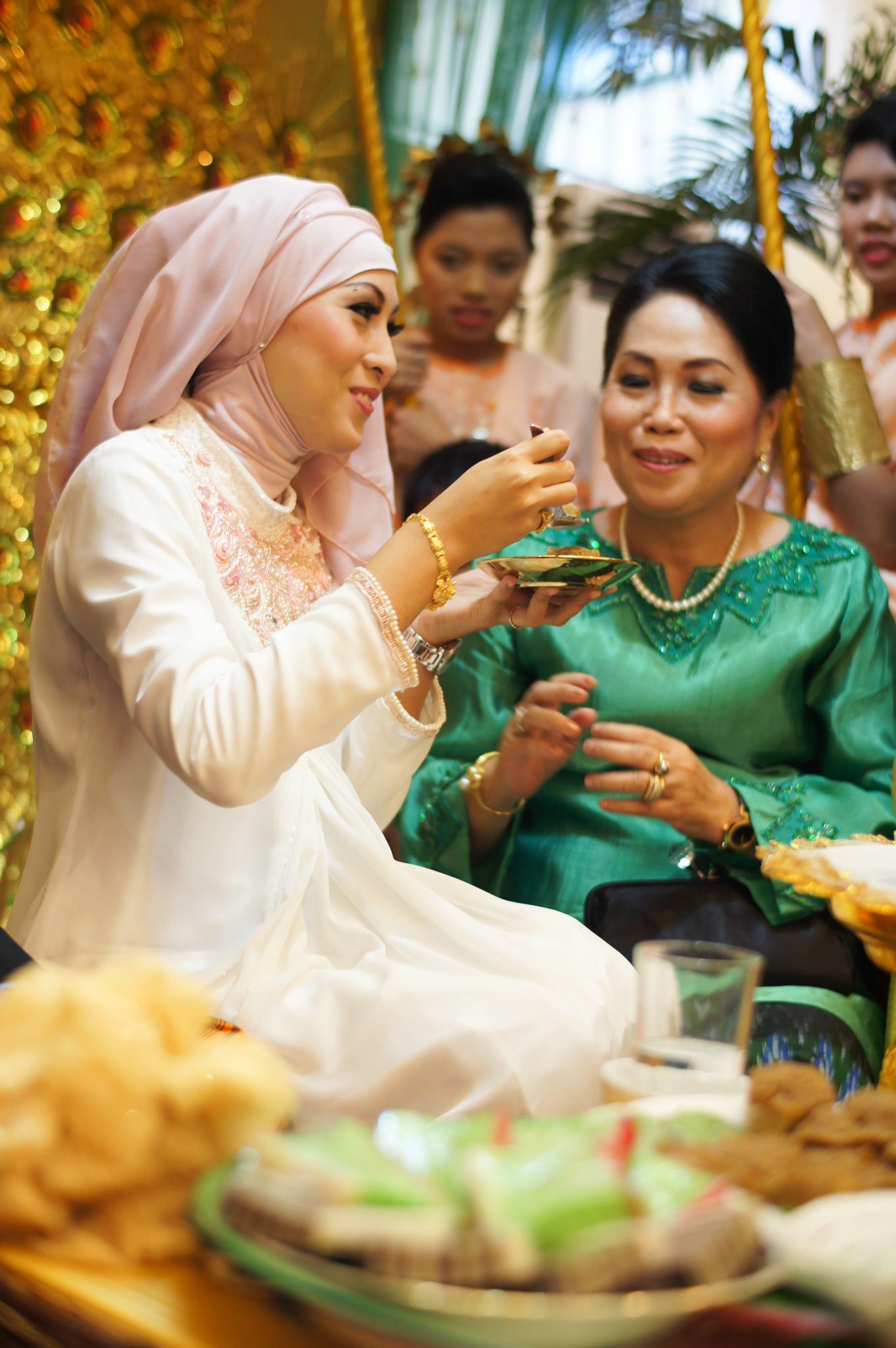 Bride feeding her mother.