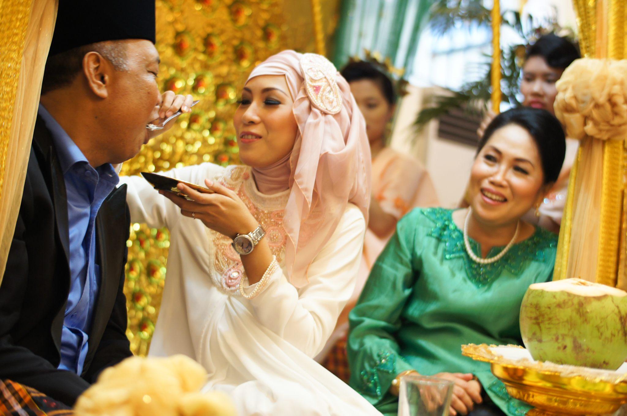 Bride feeding her father.