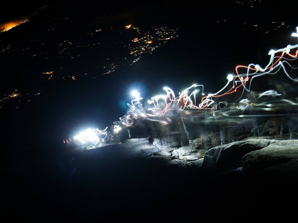 The light trail up the mountain as climbers make the early morning ascent to the summit of Mt Kinabalu in darkness with only flashlights for light.