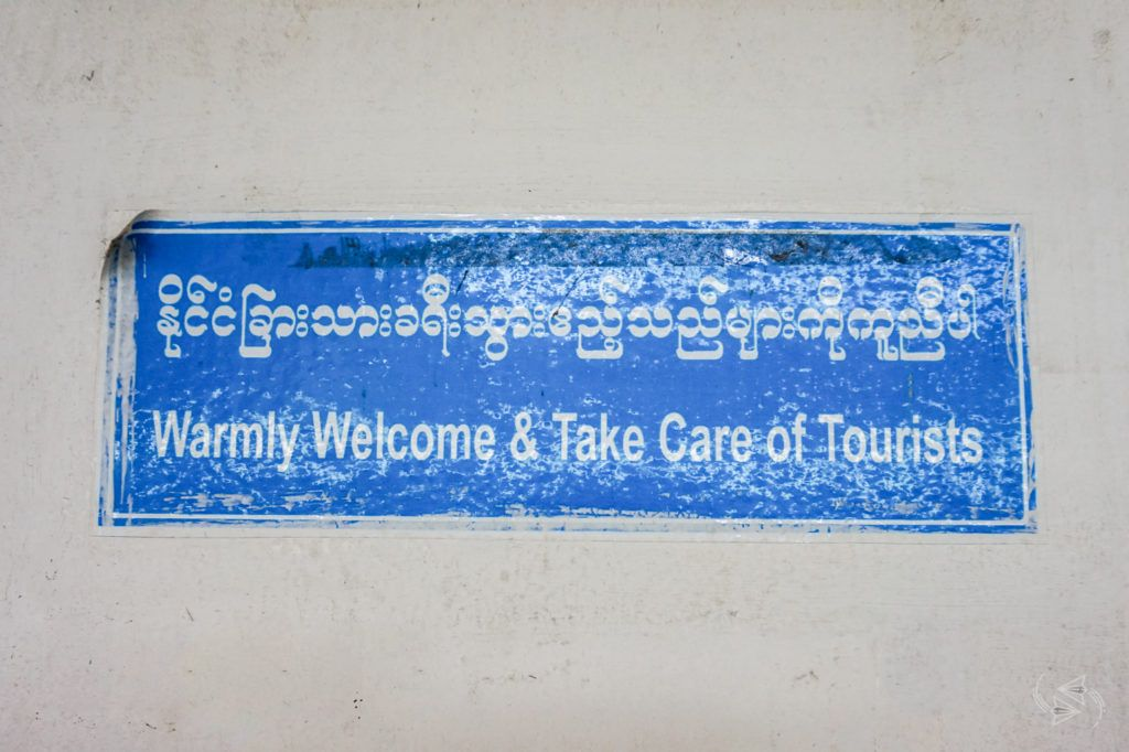 'Warmly Welcome & Take Care of Tourists' sign, Yangon Central Railway Station