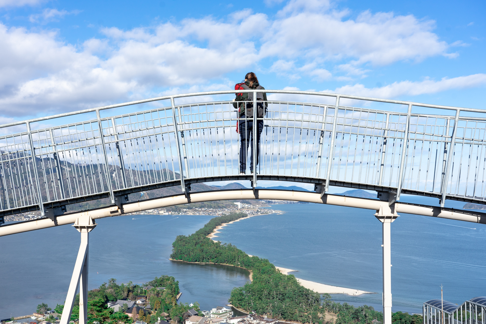 Author, Jessica Korteman, on bridge overlooking view of the Amanohashidate sandbar from Amanohashidate View Land.