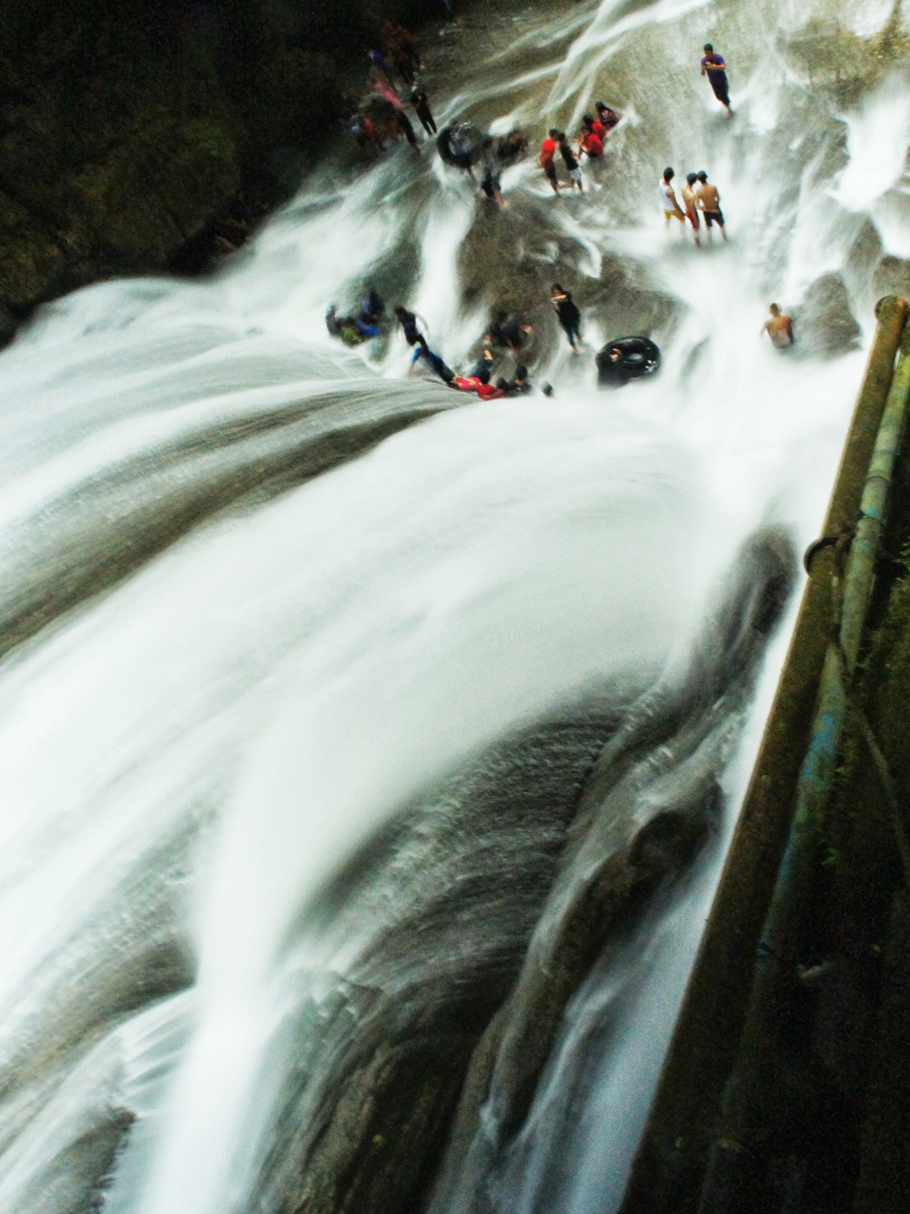 The gushing Bantimurung Waterfall from above.