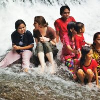 Making new friends from Kalimantan under the natural shower of the Bantimurung Waterfall.