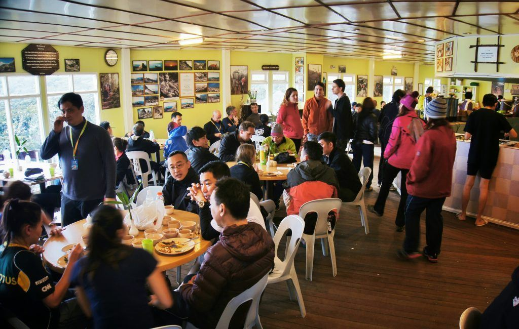 People congregated in the common eating area during dinner time at Laban Rata.