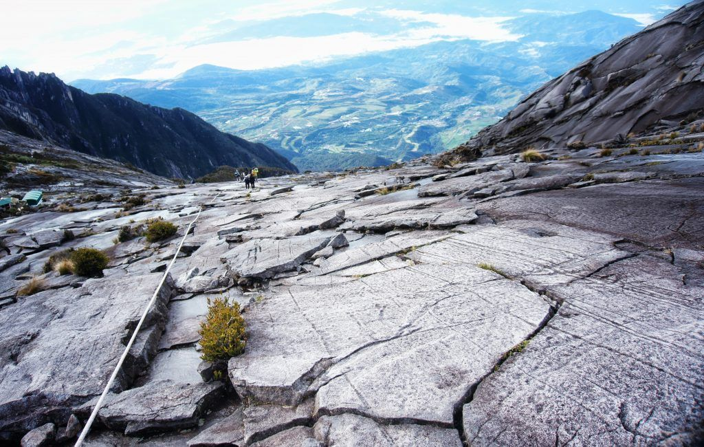 Looking down over the rockface and ropes to help climbers up from the summit of Mt Kinabalu.