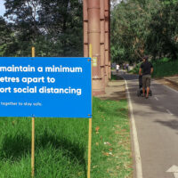 A social distancing sign beside a walking trail in Melbourne.