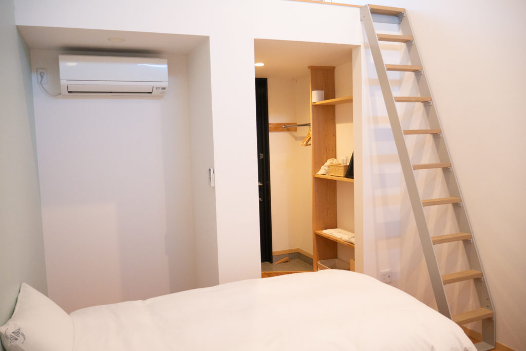 A steep ladder up to the loft and third bed in this Japanese apartment.