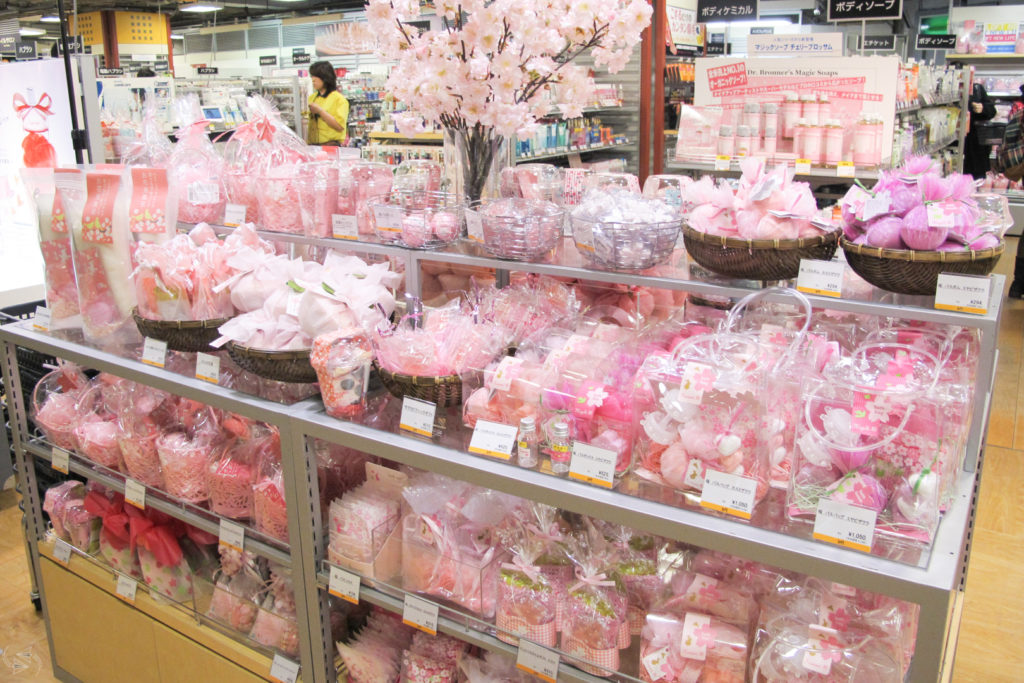 A White Day display in a department store filled with pink and white packaged bath products.
